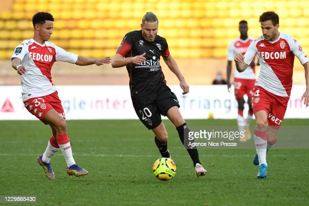 Sofiane DIOP and Cesc FABREGAS of Monaco and Renaud RIPART of Nimes during the Ligue 1 match between AS Monaco and Nimes Olympique at Stade Louis II...