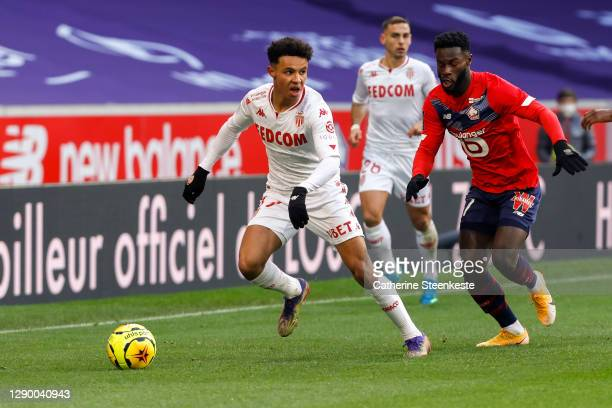 Sofiane Diop of AS Monaco controls the ball against Jonathan Bamba of Lille OSC during the Ligue 1 match between Lille OSC and AS Monaco at Stade...