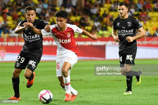 Sofiane Diop of Monaco and Sofiane Alakouch and Antonin Bobichon of Nimes during the Ligue 1 match between AS Monaco and Nimes at Stade Louis II on...