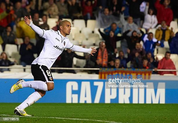 Sofiane Feghouli celebrates scoring the fourth goal during the UEFA Champions League group F match between Valencia CF and FC BATE Borisov at Estadi...
