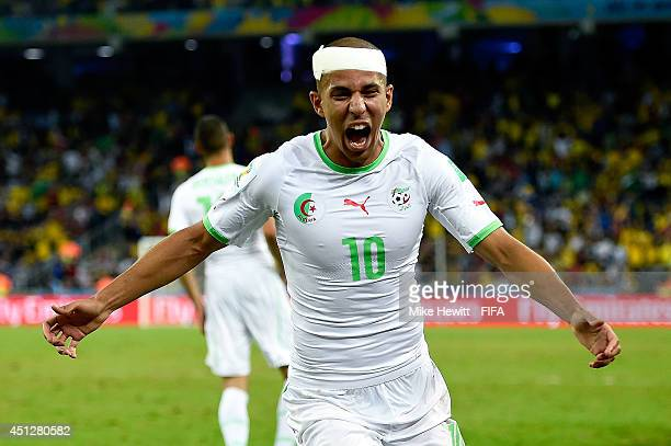 Sofiane Feghouli of Algeria celebrates his team's first goal scored by Islam Slimani during the 2014 FIFA World Cup Brazil Group H match between...