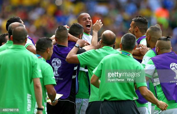Sofiane Feghouli of Algeria celebrates with teammates after scoring the team's first goal from the penalty spot during the 2014 FIFA World Cup Brazil...
