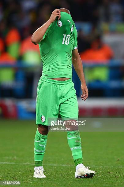 Sofiane Feghouli of Algeria reacts after being defeated by Germany 21 during the 2014 FIFA World Cup Brazil Round of 16 match between Germany and...