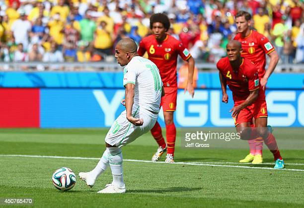 Sofiane Feghouli of Algeria scores his team's first goal on a penalty kick during the 2014 FIFA World Cup Brazil Group H match between Belgium and...