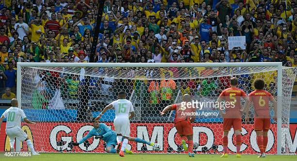 Sofiane Feghouli of Algeria scores the opening goal from the penalty spot during the 2014 FIFA World Cup Group H soccer match between Belgium and...