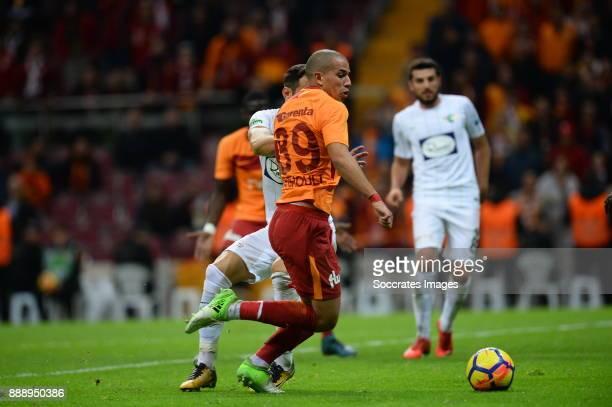 Sofiane Feghouli of Galatasaray Caner Osmanpasa of Akhisar Belediyespor during the Turkish Super lig match between Galatasaray v Akhisar Belediyespor...