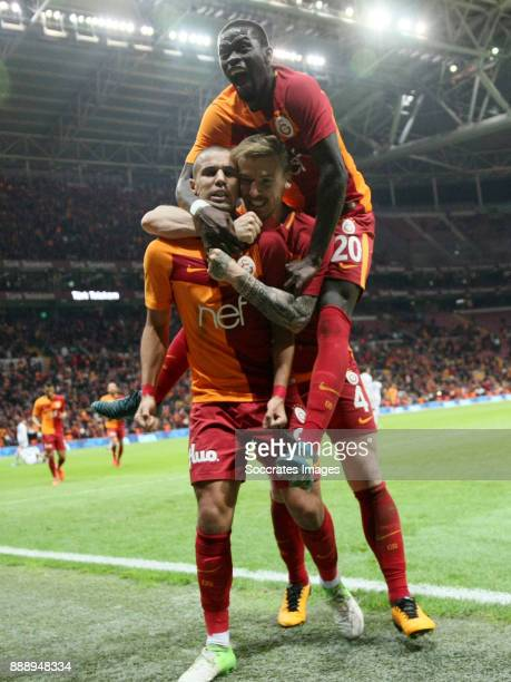 Sofiane Feghouli of Galatasaray celebrates 42 with Serdar Aziz of Galatasaray Papa Alioune NÕDiaye of Galatasaray during the Turkish Super lig match...