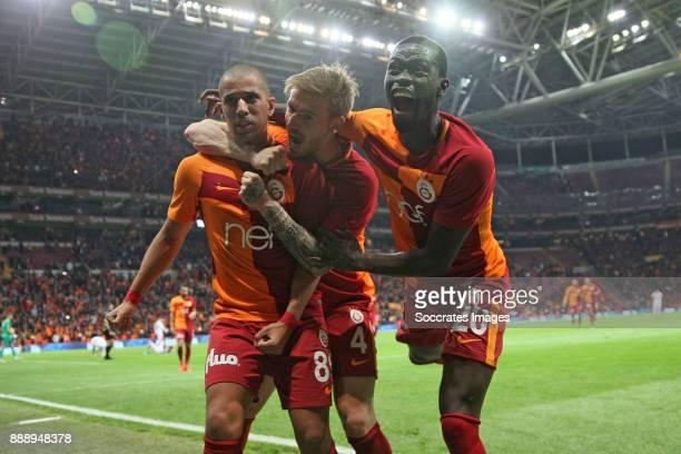 Sofiane Feghouli of Galatasaray celebrates 42 with Serdar Aziz of Galatasaray Papa Alioune NÕDiaye of Galatasaray during the Turkish Super lig match...