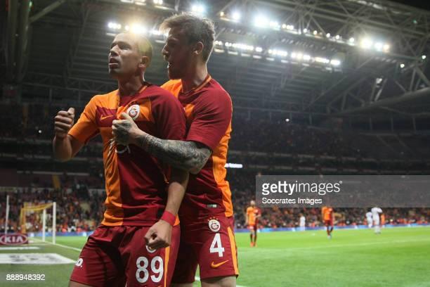 Sofiane Feghouli of Galatasaray celebrates 42 with Serdar Aziz of Galatasaray during the Turkish Super lig match between Galatasaray v Akhisar...