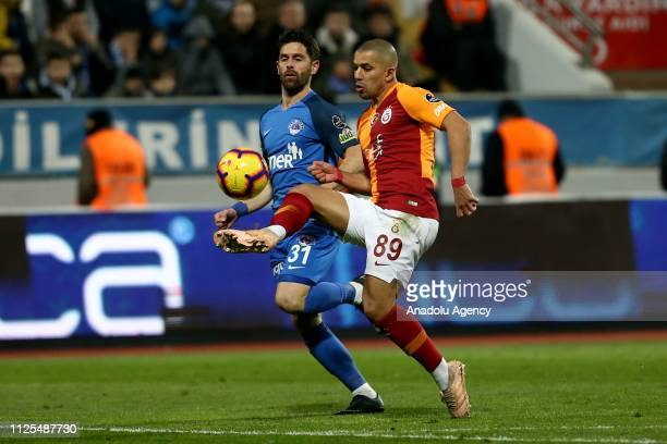 Sofiane Feghouli of Galatasaray in action against Oliver Veigneau of Kasimpasa during the Turkish Super Lig soccer match between Kasimpasa and...
