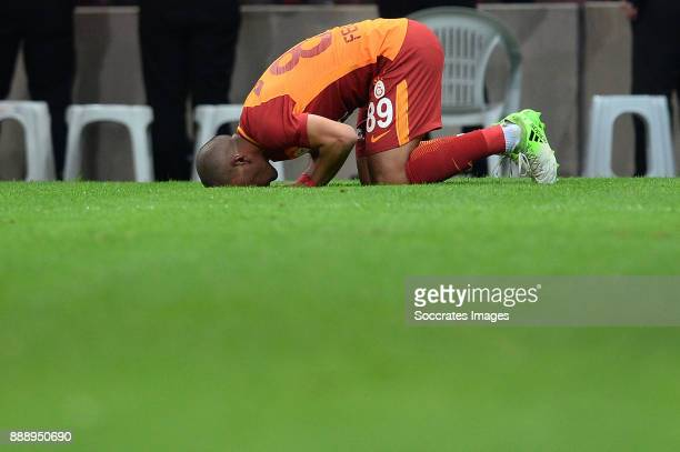 Sofiane Feghouli of Galatasaray is kissing the ground after scoring 42 during the Turkish Super lig match between Galatasaray v Akhisar Belediyespor...