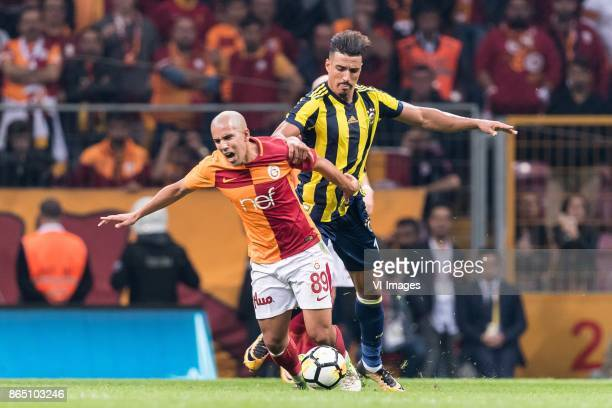 Sofiane Feghouli of Galatasaray SK Luis Carlos Novo Neto of Fenerbahce SK during the Turkish Spor Toto Super Lig football match between Galatasaray...