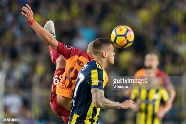 Sofiane Feghouli of Galatasaray SK Martin Skrtel of Fenerbahce SK during the Turkish Spor Toto Super Lig match Fenerbahce AS and Galatasaray AS at...