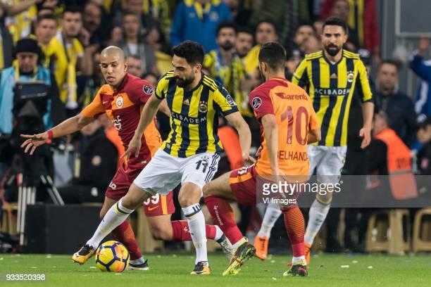 Sofiane Feghouli of Galatasaray SK Mehmet Ekici of Fenerbahce SK Younes Belhanda of Galatasaray SK Hasan Ali Kaldirim of Fenerbahce SK during the...