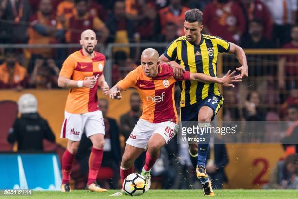 Sofiane Feghouli of Galatasaray SK Nabil Dirar of Fenerbahce SK during the Turkish Spor Toto Super Lig football match between Galatasaray SK and...