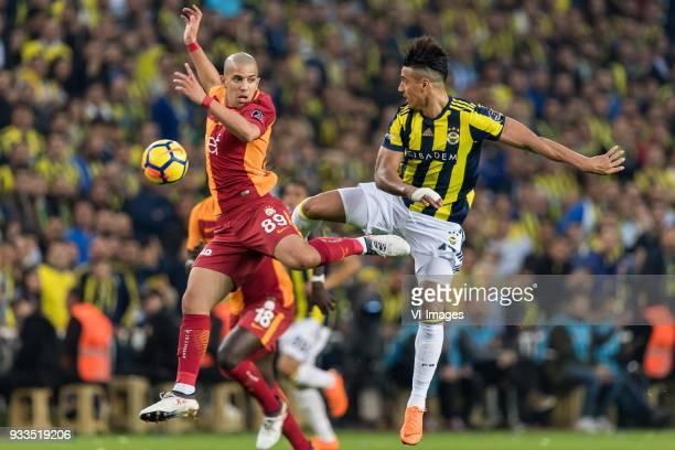 Sofiane Feghouli of Galatasaray SK Nabil Dirar of Fenerbahce SK during the Turkish Spor Toto Super Lig match Fenerbahce AS and Galatasaray AS at the...