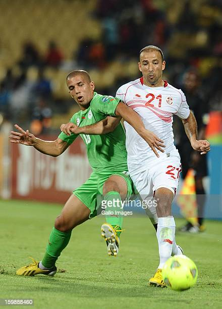 Sofiane Feghouli of Morocco competes for the ball with Khaled Mouelhi of Tunisia during the 2013 Orange African Cup of Nations match between Tunisia...