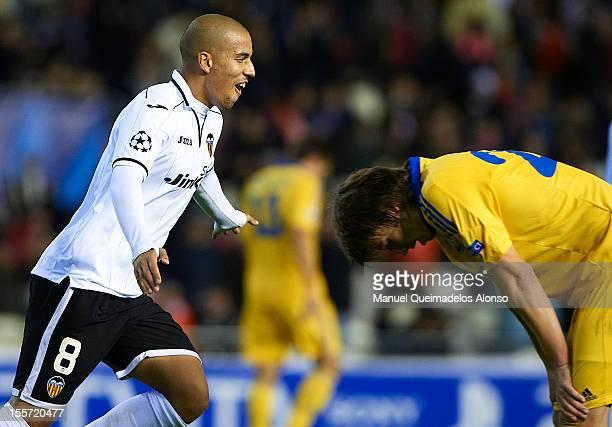 Sofiane Feghouli of Valencia celebrates scoring during the UEFA Champions League group F match between Valencia CF and FC BATE Borisov at Estadi de...