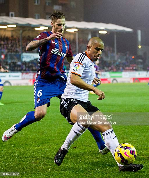 Sofiane Feghouli of Valencia CF duels for the ball with Raul Albentosa of SD Eibar during the La Liga match between SD Eibar and Valencia CF at...