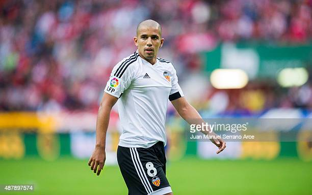 Sofiane Feghouli of Valencia CF reacts during the La Liga match between Sporting Gijon and Valencia CF at Estadio El Molinon on September 12 2015 in...