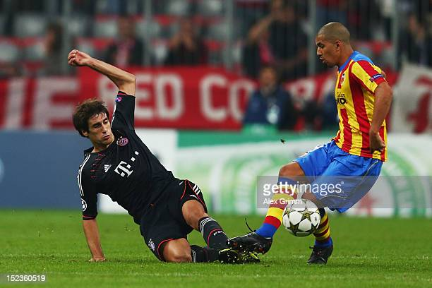 Sofiane Feghouli of Valencia is challenged by Javier Martinez of Muenchen during the UEFA Champions League group F match between FC Bayern Muenchen...