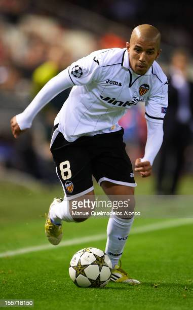 Sofiane Feghouli of Valencia runs with the ball during the UEFA Champions League group F match between Valencia CF and FC BATE Borisov at Estadi de...