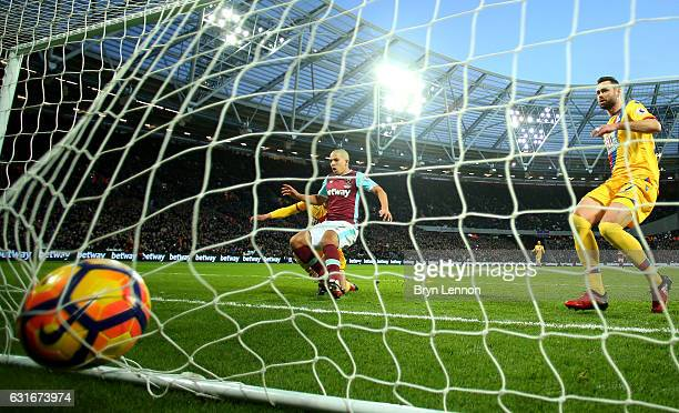 Sofiane Feghouli of West Ham Unitwins a header scores his sides first goal during the Premier League match between West Ham United and Crystal Palace...