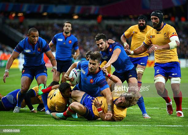 Sofiane Guitoune of France goes over to score his teams third try as he is tackled by Florin Surugiu of Romania during the 2015 Rugby World Cup Pool...