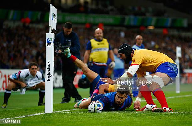 Sofiane Guitoune of France scores his teams opening try during the 2015 Rugby World Cup Pool D match between France and Romania at the Olympic...