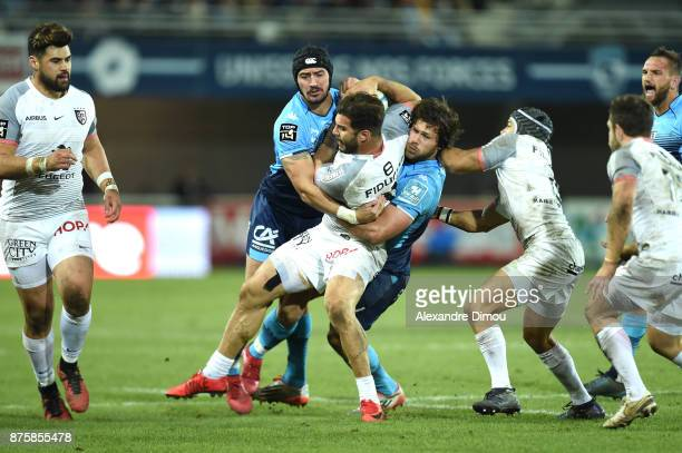 Sofiane Guitoune of Toulouse and Alexandre Dumoulin and Jan Serfontain of Montpellier during the Top 14 match between Montpellier and Toulouse on...