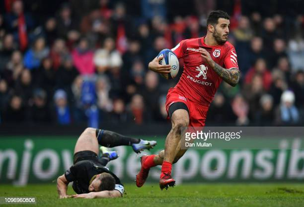 Sofiane Guitoune of Toulouse avoids the tackle of Chris Cook of Bath during the Champions Cup match between Toulouse and Bath Rugby at Stade...