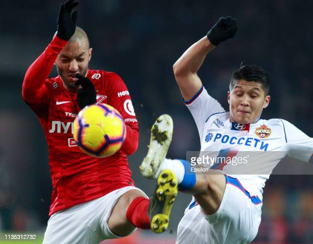 Sofiane Hanni of FC Spartak Moscow vies for the ball with Ilzat Akhmetov of PFC CSKA Moscow during the Russian Premier League match between FC...
