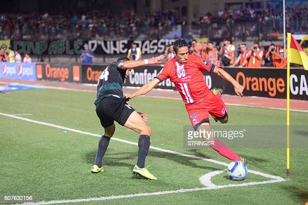 Sofiane Khadir of MO BejaiaYassir Jarici of FUS Rabat go headtohead in the first leg of the 2016 Caf Confederation Cup semifinal at the Stade de...