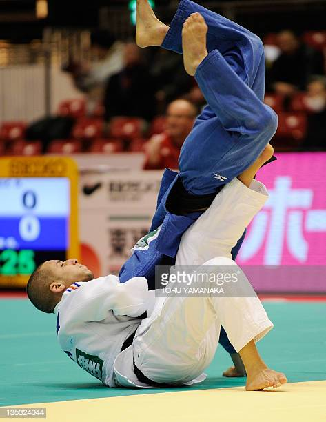 Sofiane Milous of France throws Aaron Kunihiro of the US during the men's 60kg class elimination round match in the Judo Grand Slam tournament in...