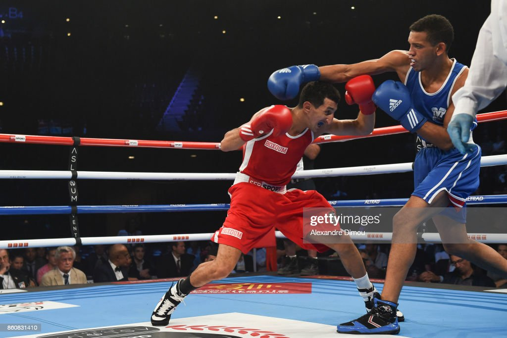 Sofiane Oumiha of France (red) and Elian Guerrero of Spain during the Boxitanie Event on October 12, 2017 in Montpellier, France.