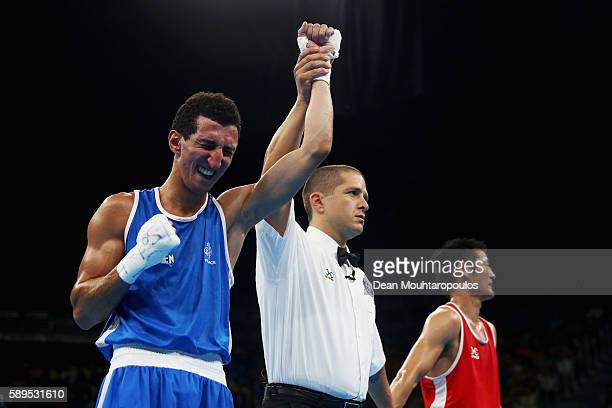 Sofiane Oumiha of France celebrates victory over Otgondalai Dorjnyambuu of Mongolia after they compete in their Lightweight 60kg men boxing bout on...