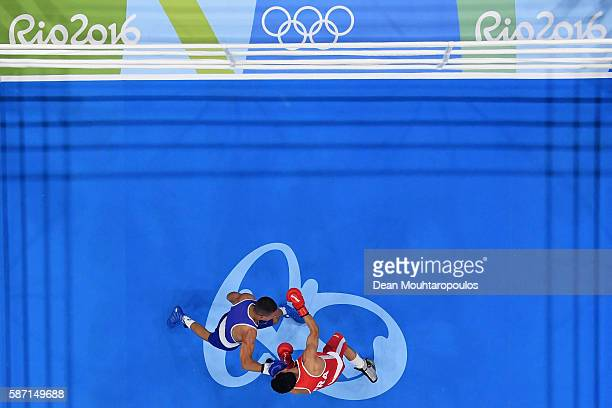 Sofiane Oumiha of France lands a punch on Teofimo Andres Lopez Rivera of Honduras as they compete in the Men's Light 60kg preliminary bout on Day 2...