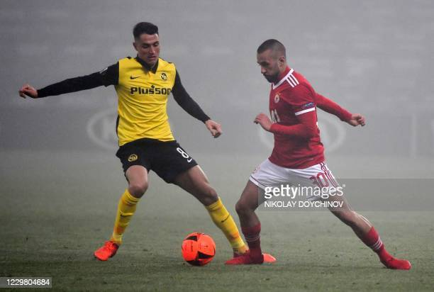 Sofia's Bulgarian forward Georgi Yomov fights for the ball with BSC Young Boys's Swiss midfielder Vincent Sierro during the UEFA during the UEFA...