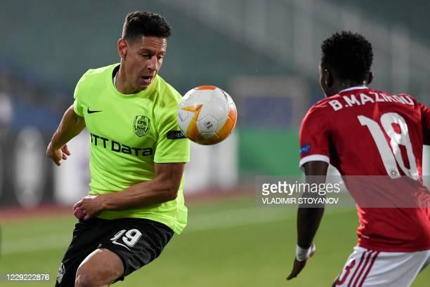Sofia's French midfielder Bradley Mazikou vies with CFR Cluj's Venezuelan forward Mario Rondon during the UEFA Europa League Group A first-leg...