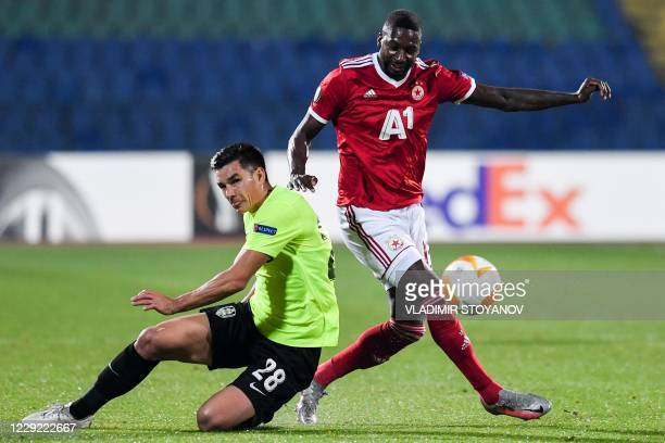 Sofia's French midfielder Younousse Sankhare vies with CFR Cluj's Romanian midfielder Ovidiu Hoban during the UEFA Europa League Group A first-leg...
