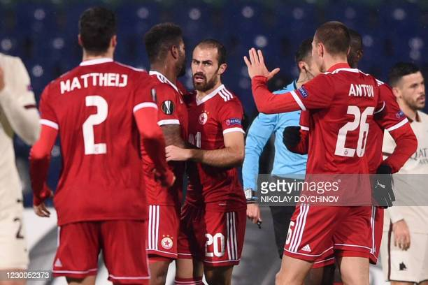 Sofia's Portoguesse midfielder Tiago Rodrigues celebrates with teammates after scoring during the UEFA Europa League Group A football match between...