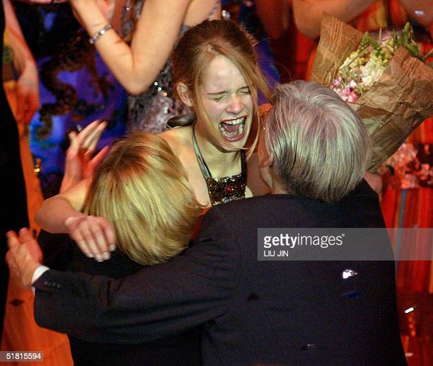 Sofie Oosterwaal from Holland embraces her parents after winning the champion of the OLAY Elite Model Look 2004 International Finals in Shanghai 02...