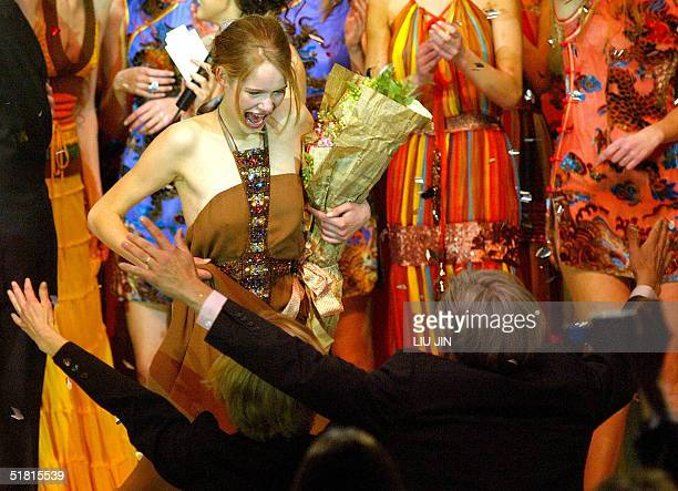 Sofie Oosterwaal from Holland is congratulated by her parents after she winning the champion of the OLAY Elite Model Look 2004 International Finals...