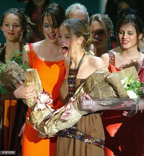 Sofie Oosterwaalal from Holland celebrates as she wins the champion of the OLAY Elite Model Look 2004 International Finals the runnerup Dana...