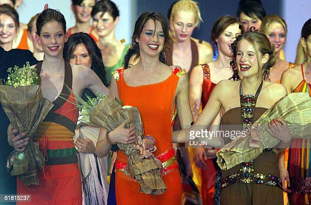 Sofie Oosterwaalal from Holland Dana Marcolina from US and Maj Bjerre from Denmark celebrate during the OLAY Elite Model Look 2004 International...