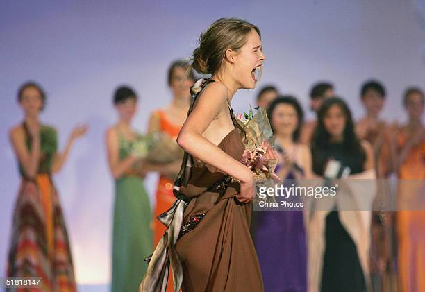 Sofie Oosterwaalal of the Netherlands celebrates after winning the OLAY Elite Model Look 2004 International Finals on December 2 2004 in Shanghai...