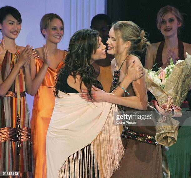 Sofie Oosterwaalal of the Netherlands is congratulated by Victoria Beckham after she won the champion of the OLAY Elite Model Look 2004 International...