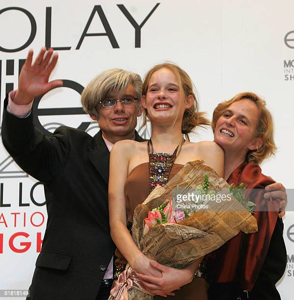 Sofie Oosterwaalal of the Netherlands poses for pictures with her parents after winning the OLAY Elite Model Look 2004 International Finals on...