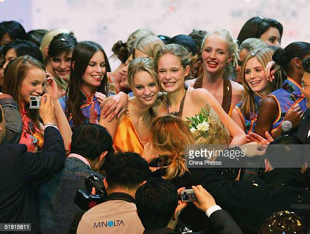Sofie Oosterwaalal of the Netherlands poses for pictures with other contestants after winning the OLAY Elite Model Look 2004 International Finals on...