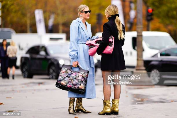 Sofie Valkiers and Thassia Naves outside Chanel during Paris Fashion Week Womenswear Spring/Summer 2019 on October 2 2018 in Paris France